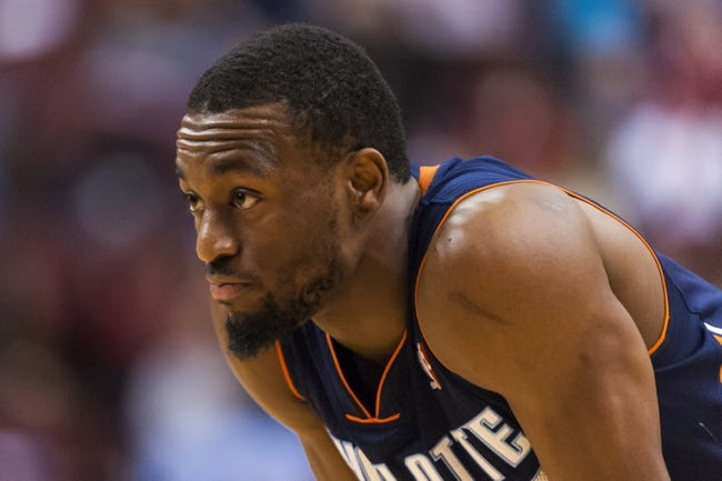 Apr 2, 2014; Philadelphia, PA, USA; Charlotte Bobcats guard Kemba Walker (15) during the first quarter against the Philadelphia 76ers at the Wells Fargo Center. The Bobcats defeated the Sixers 123-93. Mandatory Credit: Howard Smith-USA TODAY Sports
