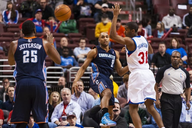 Apr 2, 2014; Philadelphia, PA, USA; Charlotte Bobcats guard Gerald Henderson (9) passes the ball to center Al Jefferson (25) during the first quarter against the Philadelphia 76ers at the Wells Fargo Center. The Bobcats defeated the Sixers 123-93. Mandatory Credit: Howard Smith-USA TODAY Sports
