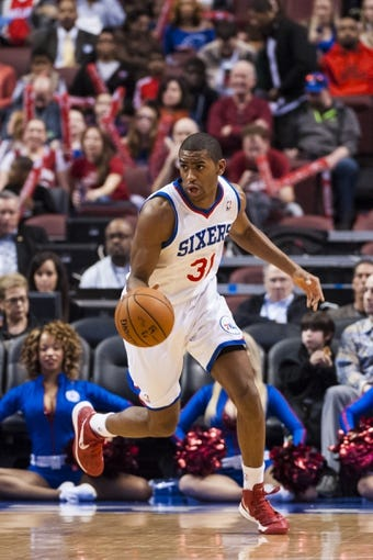 Apr 2, 2014; Philadelphia, PA, USA; Philadelphia 76ers forward Hollis Thompson (31) brings the ball up court during the first quarter against the Charlotte Bobcats at the Wells Fargo Center. The Bobcats defeated the Sixers 123-93. Mandatory Credit: Howard Smith-USA TODAY Sports