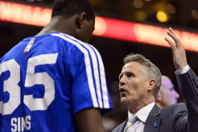 Apr 2, 2014; Philadelphia, PA, USA; Philadelphia 76ers head coach Brett Brown talks with center Henry Sims (35) during halftime against the Charlotte Bobcats at the Wells Fargo Center. The Bobcats defeated the Sixers 123-93. Mandatory Credit: Howard Smith-USA TODAY Sports