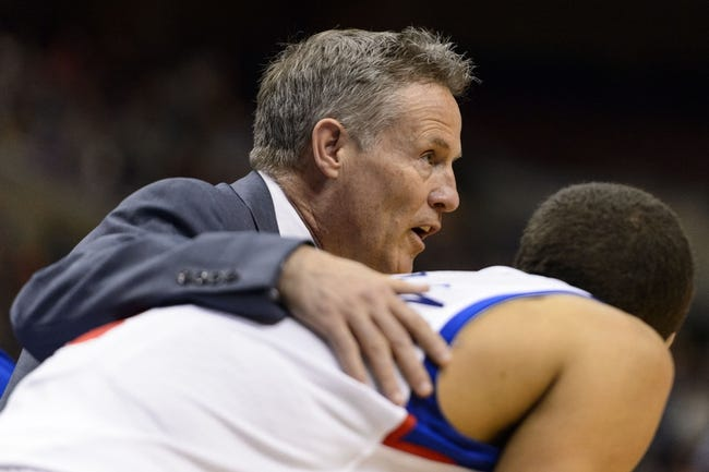 Apr 2, 2014; Philadelphia, PA, USA; Philadelphia 76ers head coach Brett Brown talks with guard Michael Carter-Williams (1) during the third quarter against the Charlotte Bobcats at the Wells Fargo Center. The Bobcats defeated the Sixers 123-93. Mandatory Credit: Howard Smith-USA TODAY Sports