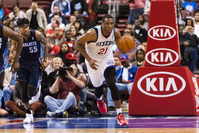 Apr 2, 2014; Philadelphia, PA, USA; Philadelphia 76ers forward Thaddeus Young (21) brings the ball up court during the fourth quarter against the Charlotte Bobcats at the Wells Fargo Center. The Bobcats defeated the Sixers 123-93. Mandatory Credit: Howard Smith-USA TODAY Sports