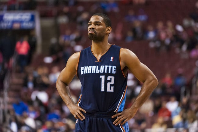 Apr 2, 2014; Philadelphia, PA, USA; Charlotte Bobcats guard Gary Neal (12) during the fourth quarter against the Philadelphia 76ers at the Wells Fargo Center. The Bobcats defeated the Sixers 123-93. Mandatory Credit: Howard Smith-USA TODAY Sports