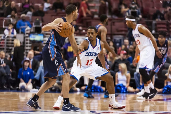 Apr 2, 2014; Philadelphia, PA, USA; Philadelphia 76ers guard Casper Ware (17) defends the dribble of Charlotte Bobcats guard Jannero Pargo (5) during the fourth quarter at the Wells Fargo Center. The Bobcats defeated the Sixers 123-93. Mandatory Credit: Howard Smith-USA TODAY Sports