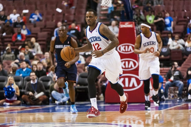 Apr 2, 2014; Philadelphia, PA, USA; Philadelphia 76ers forward James Nunnally (12) brings the ball up court during the fourth quarter against the Charlotte Bobcats at the Wells Fargo Center. The Bobcats defeated the Sixers 123-93. Mandatory Credit: Howard Smith-USA TODAY Sports