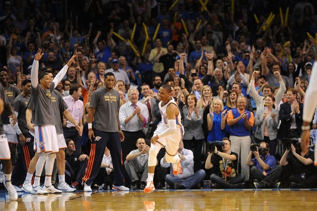 Apr 3, 2014; Oklahoma City, OK, USA; Oklahoma City Thunder guard Russell Westbrook (0) reacts after dunking the ball against the San Antonio Spurs during the fourth quarter at Chesapeake Energy Arena. Mandatory Credit: Mark D. Smith-USA TODAY Sports