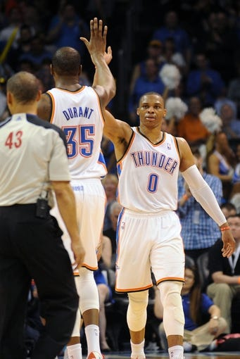 Apr 3, 2014; Oklahoma City, OK, USA; Oklahoma City Thunder guard Russell Westbrook (0) congratulates Oklahoma City Thunder forward Kevin Durant (35) after a play in action against the San Antonio Spurs at Chesapeake Energy Arena. Mandatory Credit: Mark D. Smith-USA TODAY Sports