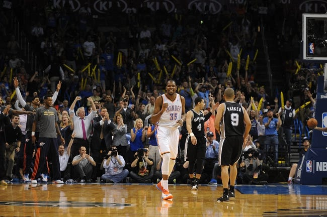 Apr 3, 2014; Oklahoma City, OK, USA; Oklahoma City Thunder forward Kevin Durant (35) reacts after a play against the San Antonio Spurs during the third quarter at Chesapeake Energy Arena. Mandatory Credit: Mark D. Smith-USA TODAY Sports