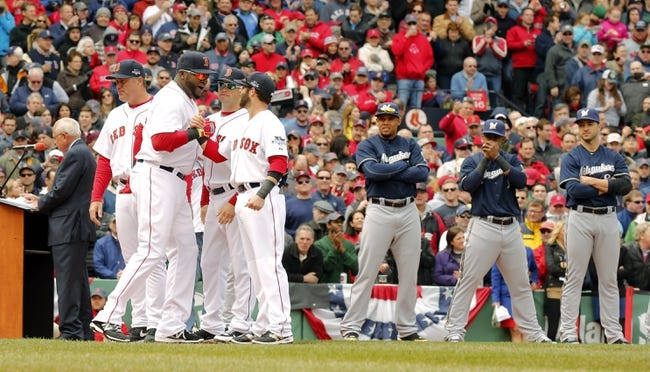Apr 4, 2014; Boston, MA, USA;  Boston Red Sox designated hitter David Ortiz (left) second baseman Dustin Pedroia (right) shake hands on the field as they are introduced before the game against the Milwaukee Brewers during pre-game ceremonies at Fenway Park. Mandatory Credit: David Butler II-USA TODAY Sports