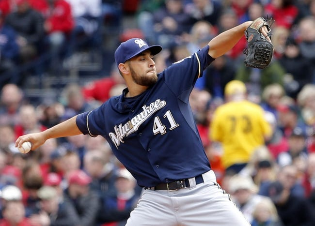 Apr 4, 2014; Boston, MA, USA; Milwaukee Brewers starting pitcher Marco Estrada (41) throws a pitch against the Boston Red Sox in the first inning of an opening day baseball game at Fenway Park. Mandatory Credit: David Butler II-USA TODAY Sports