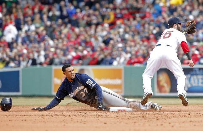 Apr 4, 2014; Boston, MA, USA; Milwaukee Brewers center fielder Carlos Gomez (27) is tagged out at second base by Boston Red Sox second baseman Dustin Pedroia (15) in the second inning at Fenway Park. Mandatory Credit: David Butler II-USA TODAY Sports