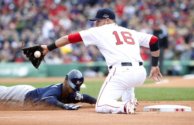 Apr 4, 2014; Boston, MA, USA; Milwaukee Brewers shortstop Jean Segura (left) safe at third as Boston Red Sox third baseman Will Middlebrooks (16) catches the throw in the second inning at Fenway Park. Mandatory Credit: David Butler II-USA TODAY Sports
