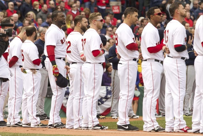 Apr 4, 2014; Boston, MA, USA; Boston Red Sox and Milwaukee Brewers players along with fans observe a moment of silence in tribute to Lieutenant Edward J. Walsh and firefighter Michael R. Kennedy during pre-game ceremonies at Fenway Park. Mandatory Credit: David Butler II-USA TODAY Sports