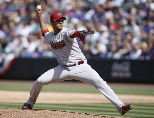 Apr 4, 2014; Denver, CO, USA; Arizona Diamondbacks starting pitcher Randall Delgado (48) delivers a pitch during the second inning against the Colorado Rockies at Coors Field. Mandatory Credit: Chris Humphreys-USA TODAY Sports