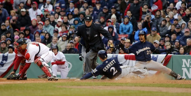 Apr 4, 2014; Boston, MA, USA; Milwaukee Brewers second baseman Scooter Gennett (2) scores a run past Boston Red Sox catcher A.J. Pierzynski (left) in the ninth inning at Fenway Park. Mandatory Credit: David Butler II-USA TODAY Sports