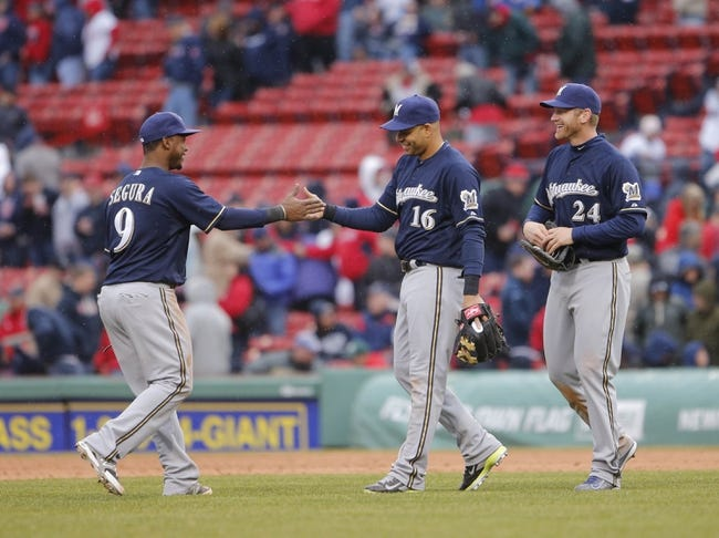 Apr 4, 2014; Boston, MA, USA; Milwaukee Brewers shortstop Jean Segura (9), third baseman Aramis Ramirez (16) and first baseman Lyle Overbay (24) react after defeating the Boston Red Sox in the ninth inning at Fenway Park. The Milwaukee Brewers defeated the Boston Red Sox 6-2. Mandatory Credit: David Butler II-USA TODAY Sports