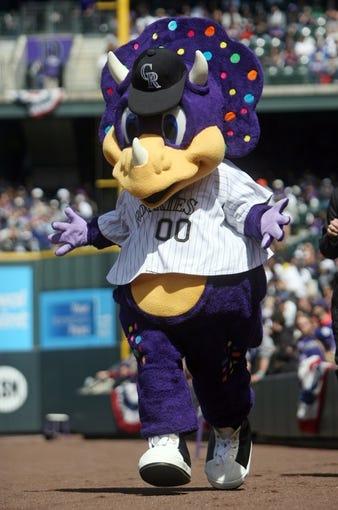 Apr 4, 2014; Denver, CO, USA; Colorado Rockies mascot Dinger before the game against the Arizona Diamondbacks at Coors Field. The Rockies won 12-2. Mandatory Credit: Chris Humphreys-USA TODAY Sports