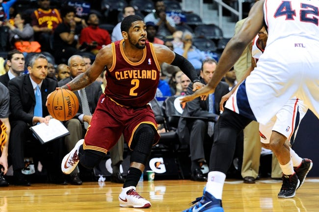Apr 4, 2014; Atlanta, GA, USA; Cleveland Cavaliers guard Kyrie Irving (2) works against the Atlanta Hawks during the first half at Philips Arena. Mandatory Credit: Dale Zanine-USA TODAY Sports