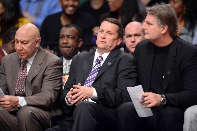 Apr 4, 2014; Brooklyn, NY, USA; Detroit Pistons head coach John Loyer looks on against the Brooklyn Nets during the first half at Barclays Center. Mandatory Credit: Joe Camporeale-USA TODAY Sports
