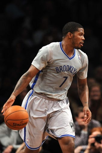 Apr 4, 2014; Brooklyn, NY, USA; Brooklyn Nets guard Joe Johnson (7) dribbles against the Detroit Pistons during the first half at Barclays Center. Mandatory Credit: Joe Camporeale-USA TODAY Sports