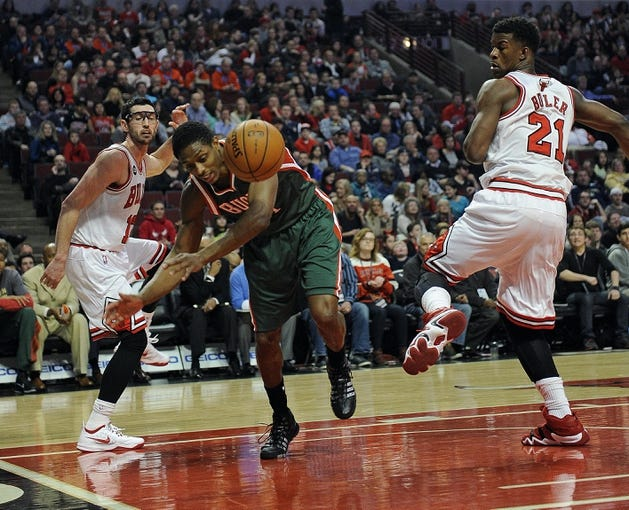 Apr 4, 2014; Chicago, IL, USA;  Milwaukee Bucks guard Brandon Knight (11) tries to save the ball from going out of bounds during a game against the Chicago Bulls during the first quarter at the United Center. Mandatory Credit: David Banks-USA TODAY Sports