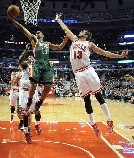 Apr 4, 2014; Chicago, IL, USA; Chicago Bulls center Joakim Noah (13) defends Milwaukee Bucks guard Ramon Sessions (13) during the first half at the United Center. Mandatory Credit: David Banks-USA TODAY Sports
