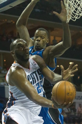 Apr 4, 2014; Charlotte, NC, USA; Charlotte Bobcats center Al Jefferson (25) shoots the ball during the second half against the Orlando Magic at Time Warner Cable Arena. The Bobcats defeated the Magic 91-80. Mandatory Credit: Jeremy Brevard-USA TODAY Sports