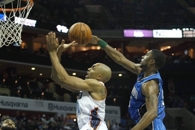 Apr 4, 2014; Charlotte, NC, USA; Charlotte Bobcats guard Gerald Henderson (9) has the ball knocked away from behind by Orlando Magic guard E'Twaun Moore (55) during the second half at Time Warner Cable Arena. The Bobcats defeated the Magic 91-80. Mandatory Credit: Jeremy Brevard-USA TODAY Sports