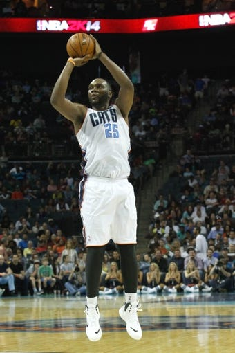 Apr 4, 2014; Charlotte, NC, USA; Charlotte Bobcats center Al Jefferson (25) shoots a three point shot during the second half against the Orlando Magic at Time Warner Cable Arena. The Bobcats defeated the Magic 91-80. Mandatory Credit: Jeremy Brevard-USA TODAY Sports