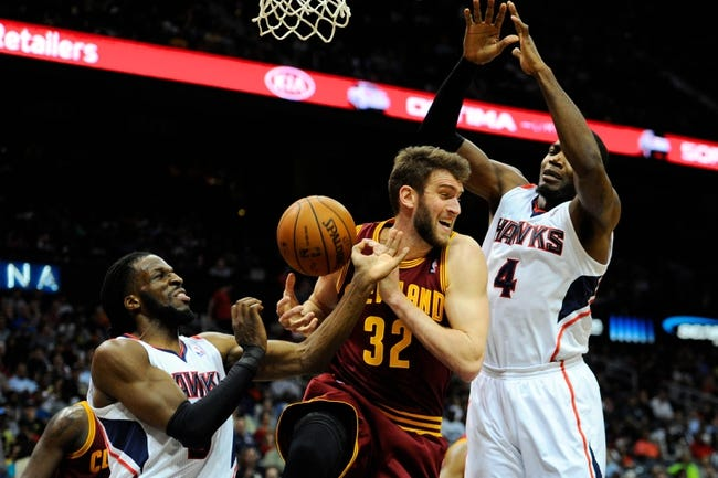 Apr 4, 2014; Atlanta, GA, USA; Atlanta Hawks forward DeMarre Carroll (5) steals the ball from Cleveland Cavaliers center Spencer Hawes (32) during the second half at Philips Arena. The Hawks defeated the Cavaliers 117-98. Mandatory Credit: Dale Zanine-USA TODAY Sports
