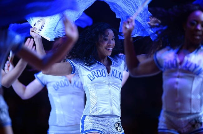 Apr 4, 2014; Brooklyn, NY, USA; The Brooklynettes perform against the Detroit Pistons during the first half at Barclays Center. The Nets won 116-104. Mandatory Credit: Joe Camporeale-USA TODAY Sports