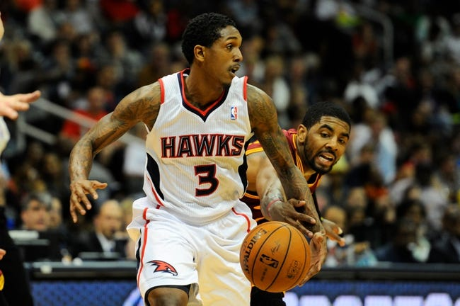 Apr 4, 2014; Atlanta, GA, USA; Atlanta Hawks guard Louis Williams (3) protects the ball from Cleveland Cavaliers guard Kyrie Irving (2) during the second half at Philips Arena. The Hawks defeated the Cavaliers 117-98. Mandatory Credit: Dale Zanine-USA TODAY Sports
