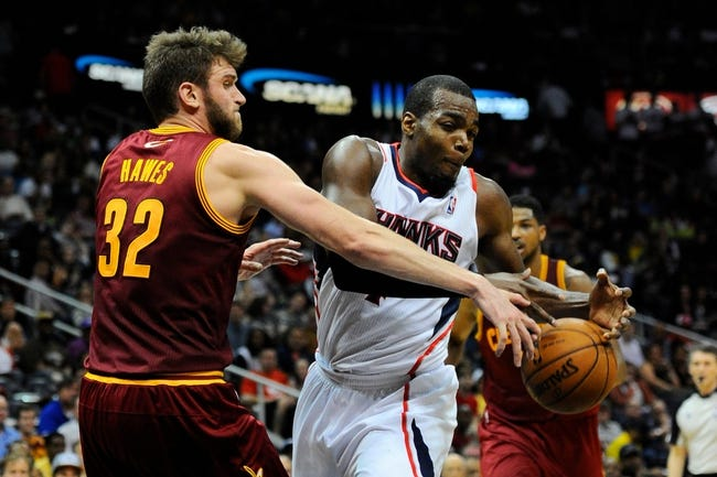 Apr 4, 2014; Atlanta, GA, USA; Atlanta Hawks forward Paul Millsap (4) fights for the ball with Cleveland Cavaliers center Spencer Hawes (32) during the second half at Philips Arena. The Hawks defeated the Cavaliers 117-98. Mandatory Credit: Dale Zanine-USA TODAY Sports