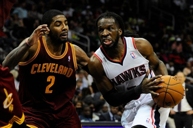 Apr 4, 2014; Atlanta, GA, USA; Atlanta Hawks forward DeMarre Carroll (5) is defended by Cleveland Cavaliers guard Kyrie Irving (2) during the second half at Philips Arena. The Hawks defeated the Cavaliers 117-98. Mandatory Credit: Dale Zanine-USA TODAY Sports