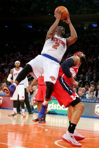 Apr 4, 2014; New York, NY, USA; New York Knicks point guard Raymond Felton (2) is fouled by Washington Wizards power forward Drew Gooden (90) during the fourth quarter of a game at Madison Square Garden. The Wizards defeated the Knicks 90-89. Mandatory Credit: Brad Penner-USA TODAY Sports
