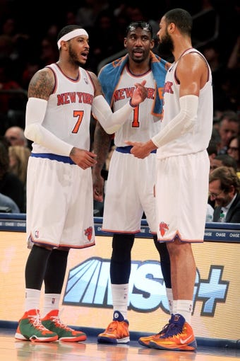Apr 4, 2014; New York, NY, USA; New York Knicks small forward Carmelo Anthony (7) and power forward Amar'e Stoudemire (1) and center Tyson Chandler (6) talk during a time out during the third quarter of a game against the Washington Wizards at Madison Square Garden. The Wizards defeated the Knicks 90-89. Mandatory Credit: Brad Penner-USA TODAY Sports