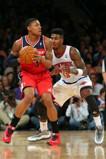 Apr 4, 2014; New York, NY, USA; Washington Wizards shooting guard Bradley Beal (3) controls the ball against New York Knicks shooting guard Iman Shumpert (21) during the fourth quarter of a game at Madison Square Garden. The Wizards defeated the Knicks 90-89. Mandatory Credit: Brad Penner-USA TODAY Sports