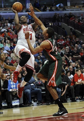 Apr 4, 2014; Chicago, IL, USA; Chicago Bulls guard Jimmy Butler (21) is guarded by Milwaukee Bucks guard Giannis Antetokounmpo (34)  during the second half at the United Center. The Chicago Bulls defeated the Milwaukee Bucks 102-90. Mandatory Credit: David Banks-USA TODAY Sports