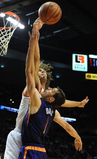 Apr 4, 2014; Portland, OR, USA; Portland Trail Blazers center Robin Lopez (42) blocks the shot of Phoenix Suns guard Goran Dragic (1) during the first quarter of the game at Moda Center. Mandatory Credit: Steve Dykes-USA TODAY Sports