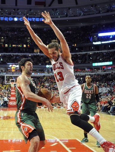 Apr 4, 2014; Chicago, IL, USA; Milwaukee Bucks center Zaza Pachulia (27) strips the ball from Chicago Bulls center Joakim Noah (13) during the second half at the United Center. The Chicago Bulls defeated the Milwaukee Bucks 102-90. Mandatory Credit: David Banks-USA TODAY Sports