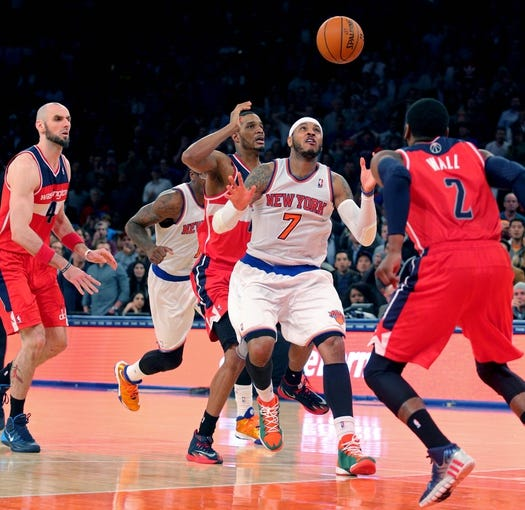 Apr 4, 2014; New York, NY, USA; New York Knicks small forward Carmelo Anthony (7) loses the ball while defended by Washington Wizards small forward Trevor Ariza (1) and Wizards point guard John Wall (2) during the fourth quarter of a game at Madison Square Garden. The Wizards defeated the Knicks 90-89. Mandatory Credit: Brad Penner-USA TODAY Sports