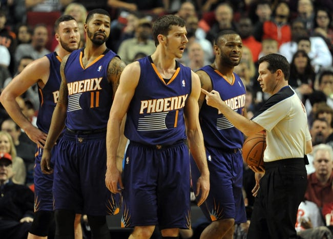 Apr 4, 2014; Portland, OR, USA; Phoenix Suns guard Goran Dragic (1) is called for a technical foul during the first quarter of the game against the Portland Trail Blazers at Moda Center. Mandatory Credit: Steve Dykes-USA TODAY Sports