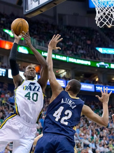 Apr 4, 2014; Salt Lake City, UT, USA; Utah Jazz forward Jeremy Evans (40) shoots against New Orleans Pelicans center Alexis Ajinca (42) during the second half at EnergySolutions Arena. The Jazz won 100-96. Mandatory Credit: Russ Isabella-USA TODAY Sports
