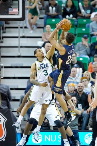 Apr 4, 2014; Salt Lake City, UT, USA; New Orleans Pelicans guard Brian Roberts (22) shoots against Utah Jazz guard Trey Burke (3) during the second half at EnergySolutions Arena. The Jazz won 100-96. Mandatory Credit: Russ Isabella-USA TODAY Sports