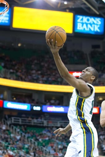 Apr 4, 2014; Salt Lake City, UT, USA; Utah Jazz guard Alec Burks (10) goes to the basket during the second half against the New Orleans Pelicans at EnergySolutions Arena. The Jazz won 100-96. Mandatory Credit: Russ Isabella-USA TODAY Sports