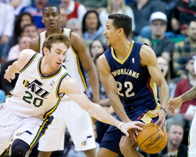 Apr 4, 2014; Salt Lake City, UT, USA; Utah Jazz guard Gordon Hayward (20) knocks the ball away from New Orleans Pelicans guard Brian Roberts (22) during the second half at EnergySolutions Arena. The Jazz won 100-96. Mandatory Credit: Russ Isabella-USA TODAY Sports