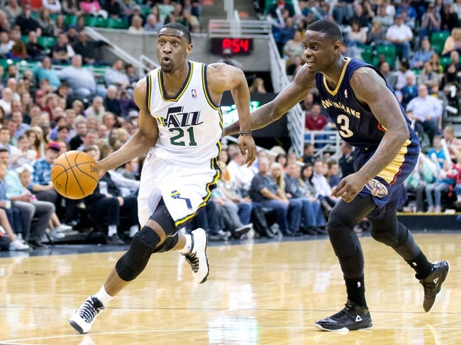 Apr 4, 2014; Salt Lake City, UT, USA; Utah Jazz guard Ian Clark (21) dribbles around New Orleans Pelicans guard Anthony Morrow (3) during the second half at EnergySolutions Arena. The Jazz won 100-96. Mandatory Credit: Russ Isabella-USA TODAY Sports