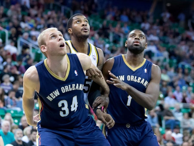 Apr 4, 2014; Salt Lake City, UT, USA; New Orleans Pelicans center Greg Stiemsma (34) and forward Tyreke Evans (1) box out Utah Jazz center Derrick Favors (15) during the second half at EnergySolutions Arena. The Jazz won 100-96. Mandatory Credit: Russ Isabella-USA TODAY Sports
