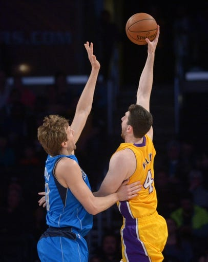 Apr 4, 2014; Los Angeles, CA, USA; Los Angeles Lakers forward Ryan Kelly (4) is defended by Dallas Mavericks forward Dirk Nowitzki (41) at Staples Center. Mandatory Credit: Kirby Lee-USA TODAY Sports