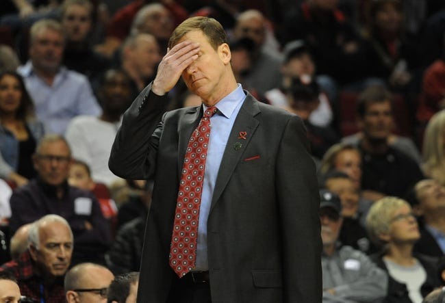 Apr 4, 2014; Portland, OR, USA; Portland Trail Blazers head coach Terry Stotts wipes his brow during the fourth quarter of the game against the Phoenix Suns at Moda Center. the Suns won the game 109-93. Mandatory Credit: Steve Dykes-USA TODAY Sports